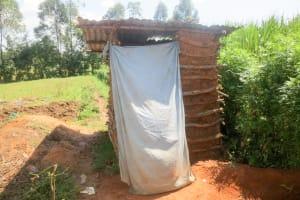 The Water Project: Shihingo Community, Mangweli Spring -  Sample Latrine