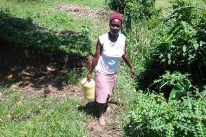 The Water Project: Mukoko Community, Mukoko Spring -  Carrying Water Home