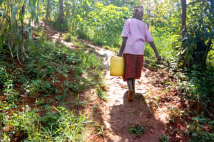 The Water Project: Sichinji Community, Makhatse Spring -  Carrying Water Home