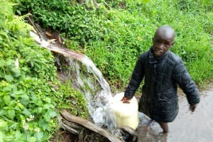 The Water Project: Bukhakunga Community, Khayati Spring -  Clyde Filling A Jerrycan