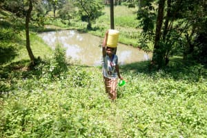 The Water Project: Rosterman Community, Kidiga Spring -  Carrying Water