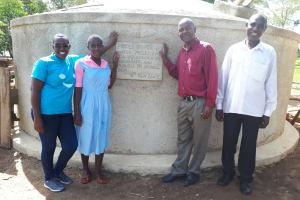 The Water Project: Muhudu Primary School -  Field Officer Janet Kayi Wilikister Kageha Deputy Headteacher David Ivayo Imbayia And Solomon Msolo