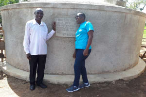 The Water Project: Muhudu Primary School -  Solomon Msolo Board Chair At Muhudu Primary With Janet At The Tank