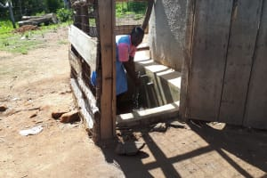 The Water Project: Muhudu Primary School -  Wilikister Kageha Fetching Water At The Tank