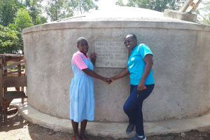 The Water Project: Muhudu Primary School -  Wilikister Kageha With Field Officer Janet Kayi At The Water Tank