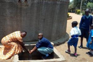 The Water Project: Shibale Primary School -  Field Officer Betty Majani And Precious Adhiambo