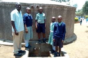 The Water Project: Shibale Primary School -  Headteacher Simon Khalumi And Students At The Tank