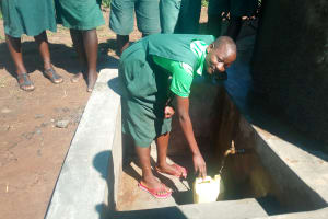 The Water Project: Emusoma Primary School -  Student Fetches Water At The Tank
