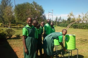 The Water Project: Emusoma Primary School -  Students Using Handwashing Stations