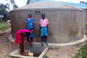 The Water Project: Maganyi Primary School -  Sheila Msilivi Fetches Water With Brevisious Lugadilo And Diana Mukhono
