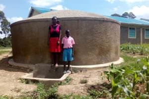 The Water Project: Maganyi Primary School -  Sheila Msilivi With Brevisious Lugadilo