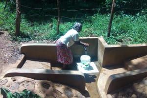 The Water Project: Irenji Community, Shianda Spring -  Ruth Ayoli Enjoys Water At The Spring
