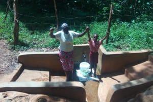 The Water Project: Irenji Community, Shianda Spring -  Ruth Ayoli With Bravin Mumala At The Spring