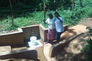 The Water Project: Irenji Community, Shianda Spring -  Ruth Ayoyi And Field Officer Jacklyne Chelagat