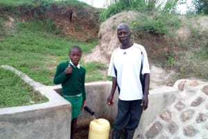 The Water Project: Futsi Fuvili Community, Shikanga Spring -  Jacob Askari Poses At The Spring