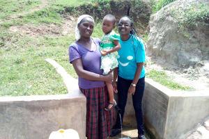 The Water Project: Futsi Fuvili Community, Shikanga Spring -  Rebecca Askari Her Daughter And Field Officer Joan Were