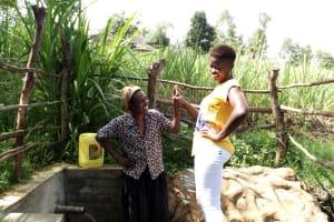 The Water Project: Futsi Fuvili Community, Patrick Munyalo Spring -  Naomi Osula And Field Officer Jemmimah Khasoha
