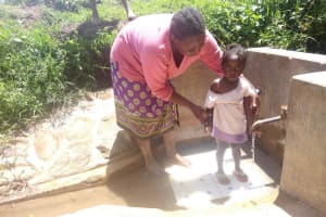 The Water Project: Kakubudu Community, Fred Lagueni Spring -  Agripinna Livivi And Ashely Lukatsiva