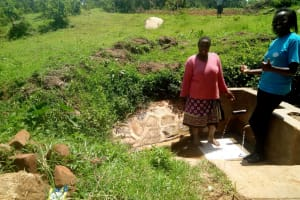 The Water Project: Kakubudu Community, Fred Lagueni Spring -  Agripinna Livivi And Field Officer Olivia Bomji