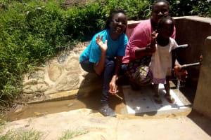 The Water Project: Kakubudu Community, Fred Lagueni Spring -  Field Officer Olivia Bomji Agripinna Livivi And Ashely Lukatsiva