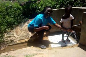 The Water Project: Kakubudu Community, Fred Lagueni Spring -  Field Officer Olivia Bomji And Ashely Lukatsiva