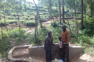 The Water Project: Mkunzulu Community, Museywa Spring -  Shadrack Mwochi Clarence Akanga And Field Officer Wilson Kipchoge