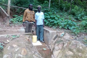 The Water Project: Elunyu Community, Saina Spring -  Field Officer Wilson Kipchoge And Herman Kaongeli