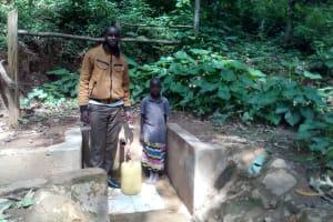 The Water Project: Elunyu Community, Saina Spring -  Field Officer Wilson Kipchoge And Maximila Nekesa