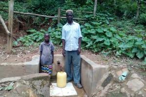 The Water Project: Elunyu Community, Saina Spring -  Herman Kaongeli With Maximila Nekesa