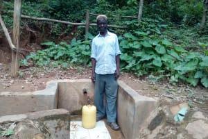 The Water Project: Elunyu Community, Saina Spring -  Herman Kaongeli