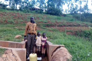 The Water Project: Simuli Community, Lihala Sifoto Spring -  Field Officer Wilson Kipchoge Rebecca Asiko And Her Friend