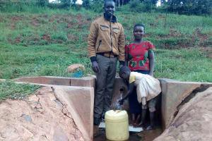 The Water Project: Simuli Community, Lihala Sifoto Spring -  Field Officer Wilson Kipchoge With Irene Munyasa And Rebecca Asiko