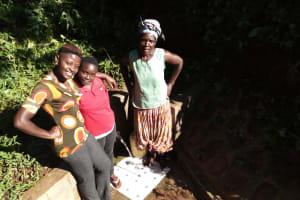 The Water Project: Emusanda Community, Walusia Spring -  Field Officer Jemmimah Khasoha Clare Musilivi And Angelina Omumia