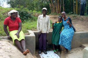 The Water Project: Shikoti Community, Amboka Spring -  Bassiliano Amboka Bridgit Shiundu And Field Officer Joan Were