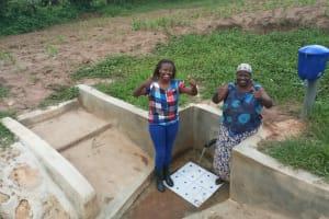 The Water Project: Mulundu Community, Fanice Mwango Spring -  Field Officer Faith Muthama And Rose Atira