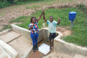 The Water Project: Mulundu Community, Fanice Mwango Spring -  Field Officer Faith Muthama And Bonface Ouko