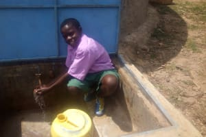 The Water Project: Chandolo Primary School -  A Student Fetches Water At The Tank