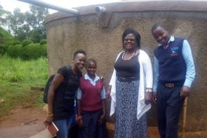 The Water Project: Ebubayi Secondary School -  Field Officer Lillian Achieng And Esther Minayo With Headteacher Veronica Onacha