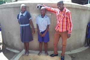 The Water Project: Namalenge Primary School -  Lvenda Adeya And Owen Wanaami With Field Officer Jonathan Mutai