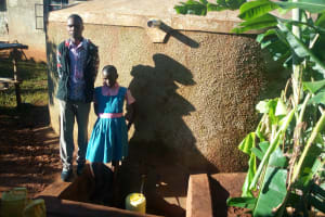The Water Project: Mudete Primary School -  Collecting Water At The Tank A Year After It Was Constructed