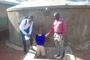 The Water Project: Gidagadi Primary School -  Field Officer Samuel Simdi Emmanuel Mbali And Teddy Liabeha