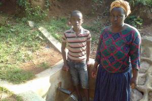 The Water Project: Gidagadi Community, Anusu Spring -  Brighton Mudonyi With Lydia Sayo At The Spring