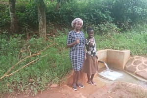 The Water Project: Mtao Community, Tifina Odari Spring -  Field Officer Faith Muthama And Mitchell Lumbasi