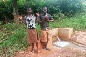 The Water Project: Mtao Community, Tifina Odari Spring -  Mitchell Lumbasi And Bruce Silas