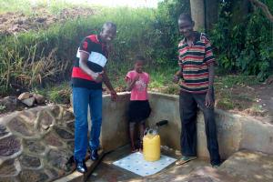 The Water Project: Luyeshe Community, Simwa Spring -  Field Officer Jonathan Mutai Mercy Simwa And Simion Simwa