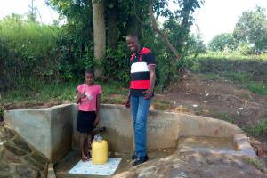 The Water Project: Luyeshe Community, Simwa Spring -  Mercy Simwa And Field Officer Jonathan Mutai