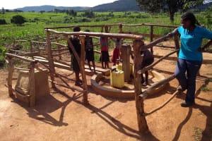 The Water Project: Rubani-Kyawalayi Community -  Community Members Using The Water Point