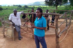 The Water Project: Rubani-Kyawalayi Community -  Field Officer Chatting With The Community Members