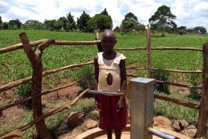 The Water Project: Byebega-Kirisa Community -  Bridget Tumusiime A Community Pupil At The Well