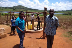 The Water Project: Maiha-Kayanja Community -  Wandera Johnson With Field Officer Olive